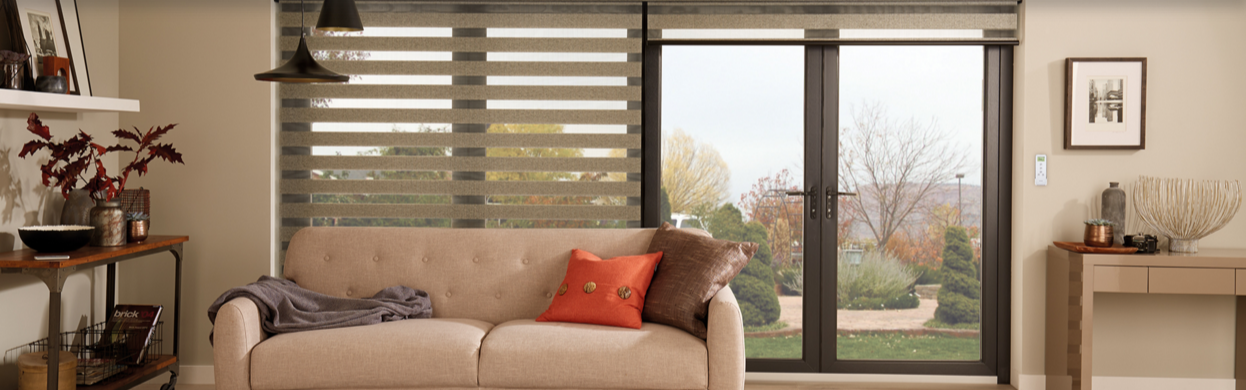An image showing Louvolite® electric roller blinds in a living room