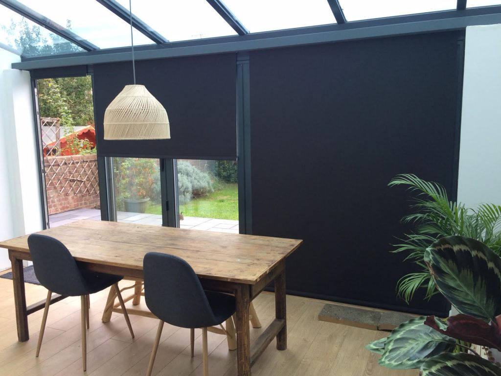 An image showing thermal window blinds in black in a kitchen