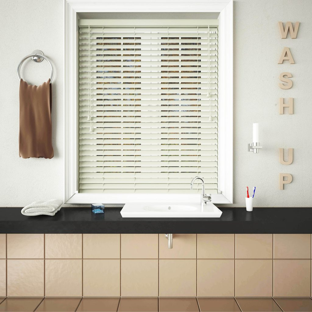 An image showing off-white wooden blinds fitted into a neutral kitchen space to match the walls