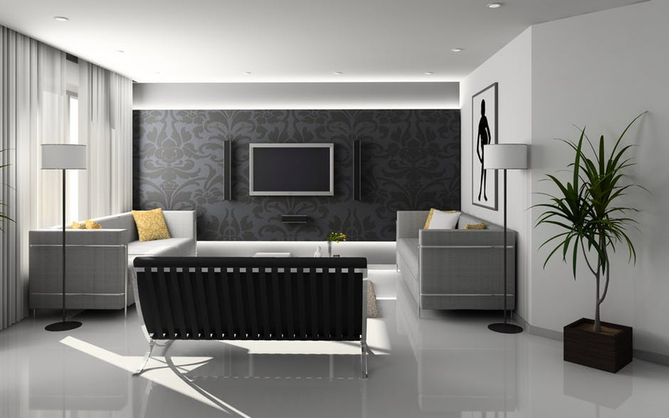 An image showing a grey living room with grey blind, grey sofa and grey walls