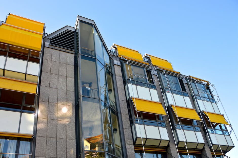 An image showing bright yellow awnings installed on a modern office block